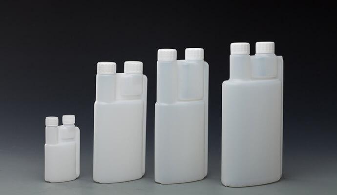 Twin chamber measuring bottle